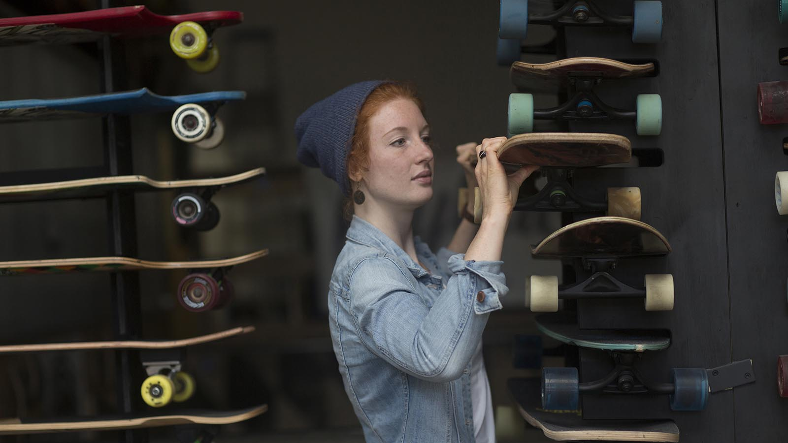Woman working in a skateboard shop